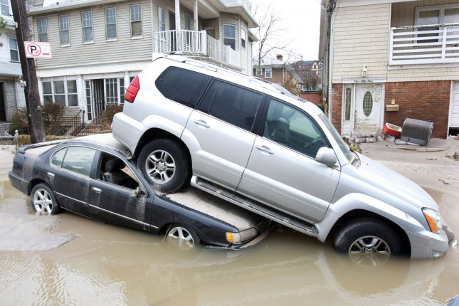 Damaged vehicles are stacked on top of each other after Hurricane Sandy inundated the Rockaway Peninsular in Queens, New York, on October 30, 2012. File Photo by Monika Graff/UPI