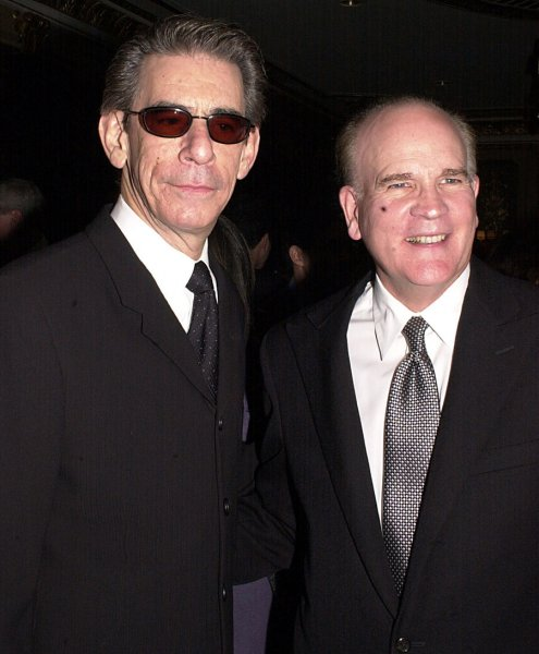 NYP2002103108 - NEW YORK, Oct. 31 (UPI)--Actor Richard Belzer of the NBC tv series Law and Order (left) poses with Bob Wright, GE Vice Chairman and NBC Chairman & CEO at the Oct. 31, 2002 Center for Communication awards ceremonies honoring Wright for Excellence in Communication. jg/ep/Ezio Petersen UPI
