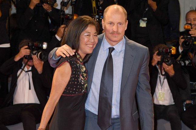 Woody Harrelson (R) pictured here his wife Laura Louie, is set to star in Netflix's Highwaymen alongside Kevin Costner. File Photo by Paul Treadway/UPI