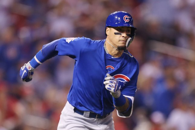 Chicago Cubs' Javier Baez takes off for first base, hitting a two RBI double in the fifth inning against the St. Louis Cardinals on Sunday at Busch Stadium in St. Louis. Photo by Bill Greenblatt/UPI
