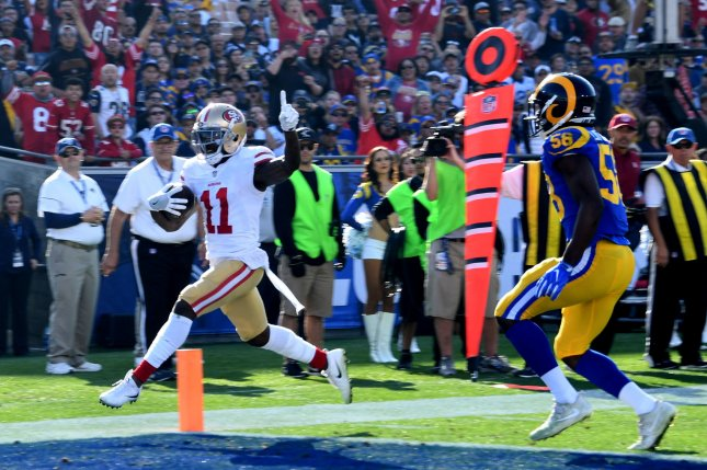 San Francisco 49ers receiver Marquise Goodwin (L) scores against the Los Angeles Rams on December 31 in Los Angeles. Photo by Jon SooHoo/UPI