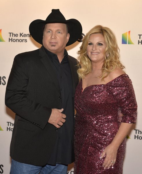 Country music husband and wife duo Garth Brooks and Trisha Yearwood will perform live for a concert event on CBS Wednesday.  File Photo by Mike Theiler/UPI