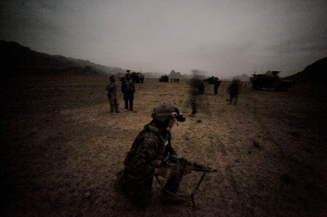 A MARSOC Marine holds security while coalition forces set up camp for the evening in the hills of Farah Provence, Afghanistan on February 25, 2010. Afghan National Army from the 2/2/207th Kandak, Italian Army Operational Mentoring Liaison Team and Marines from the Marine Special Operation Command conduct a combat reconnaissance patrol through the mountainous region of Farah. UPI/Nicholas Pilch/U.S. Air Force.
