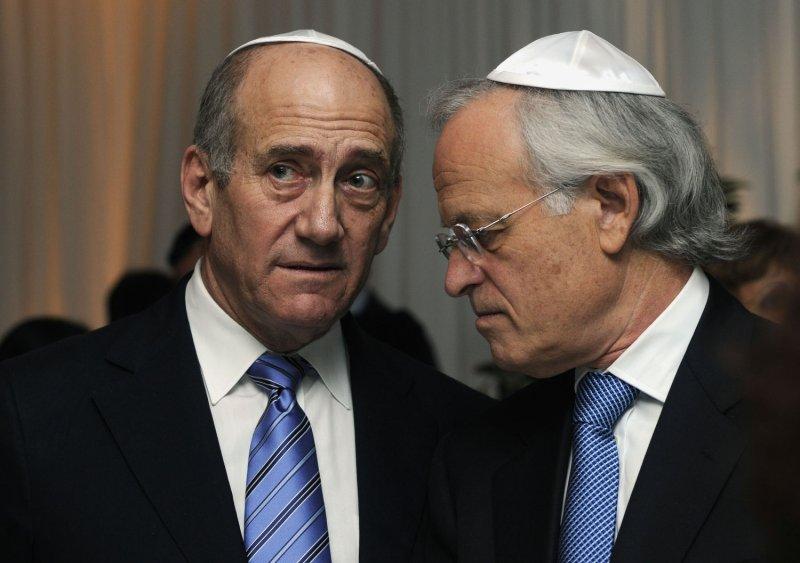 Israeli Prime Minister Ehud Olmert (L) and former U.S. Ambassador to Israel Martin Indyk attend the National Security Studies Security Challenges of the 21st. Century Conference in Tel Aviv, December 11, 2007. (UPI Photo/Debbie Hill)