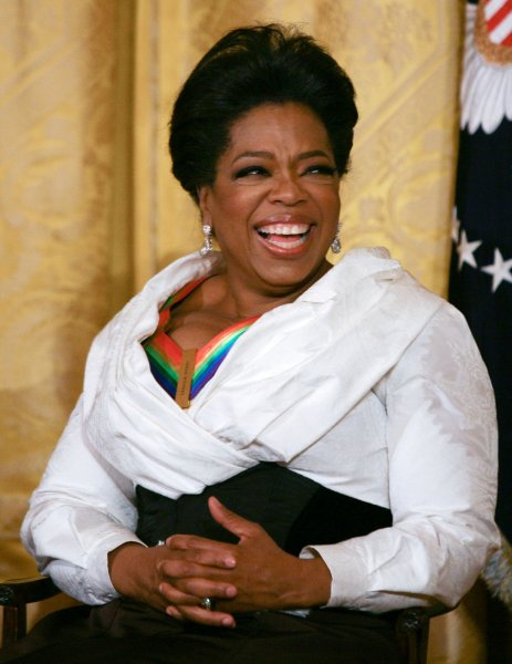 Oprah Winfrey smiles as she listens to remarks by U.S. President Barack Obama as the president and First Lady Michelle Obama host the 2010 Kennedy Center Honorees at a reception in the East Room of the White House before going to the Kennedy Center on December 5, 2010. The recipients for the 33rd annual awards are singer and songwriter Merle Haggard; composer and lyricist Jerry Herman; dancer, choreographer and director Bill T. Jones; songwriter and musician Paul McCartney; and producer, television host and actress Oprah Winfrey. UPI/Gary Fabiano/Pool