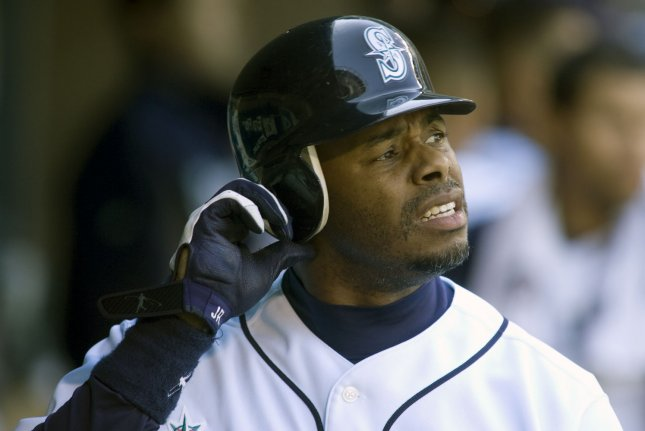 Seattle Mariners' Ken Griffey Jr. removes his helmet after hitting a three run RBI homer to right field against the New York Yankees in the second inning at SAFECO Field in Seattle on September 20, 2009. The Mariners beat the Yankees 7-1. UPI /Jim Bryant.