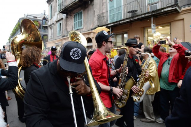 Arcade Fire and the Preservation Hall Jazz Band march down Royal Street as they play during a traditional jazz funeral for rock legend David Bowie in the French Quarter in New Orleans, Louisiana on January 16, 2016. Thousands of fans crowded the streets to take part as the Second Line in the parade for Bowie, who died last week at that age of 69. Photo by Pat Benic/UPI