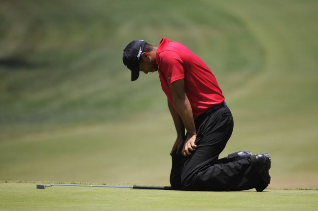 Tiger Woods reacts after missing a putt during a playoff round of the U.S. Open at Torrey Pines Golf Course in La Jolla, California, June 16, 2008. Woods was treated and released at a hospital on November 27, 2009, after his car slammed into a fire hydrant and tree near his home in suburban Orlando, Fla. Photo by Kevin Dietsch/UPI
