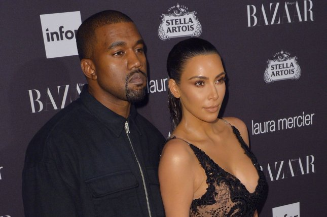 Kim Kardashian (R) and Kanye West attend the Harper's Bazaar Icons party on September 9, 2016. The couple welcomed son Saint West in December 2015. File Photo by Andrea Hanks/UPI