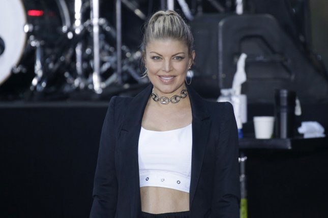 Fergie captured a video of son Axl Jack singing and dancing to the Beastie Boys on Josh Duhamel's birthday. File Photo by John Angelillo/UPI