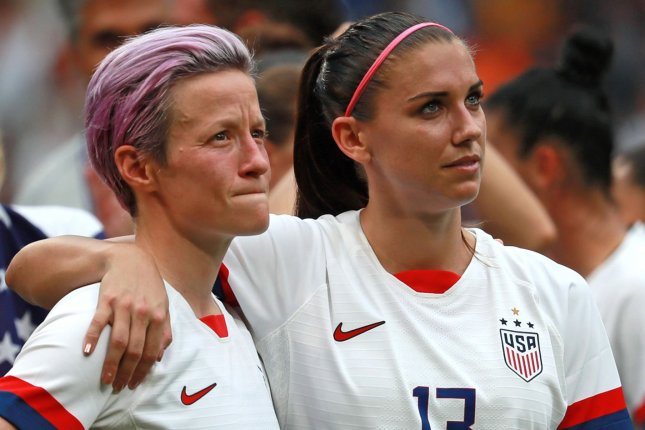 The U.S. Soccer Federation argues that Megan Rapinoe (L) and Alex Morgan were among four players who each earned more money than the highest-paid men's national team player in four of six years since 2014. File Photo by David Silpa/UPI