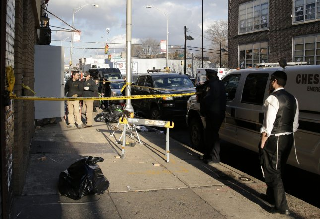The owner of a New Jersey pawn shop was arrested for illegally possessing weapons after being connected to the suspects in a Jersey City shooting that left four people dead. Photo by John Angelillo/UPI