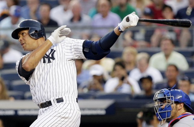 Alex Rodriguez, shown in a game July 16, was hit by a pitch and suffered a broken hand Tuesday. The Yankees on Wednesday put the third baseman on the disabled list. UPI/John Angelillo