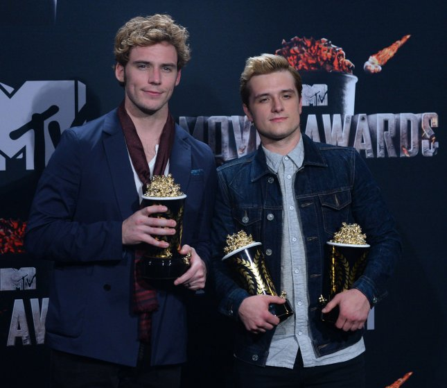 Actors Sam Claflin (L) and Josh Hutcherson appear backstage with their awards they won for Best Movie of the Year - The Hunger Games: Catching Fire at the MTV Movie Awards at Nokia Theatre L.A. Live in Los Angeles, California on April 13, 2014. UPI/Jim Ruymen