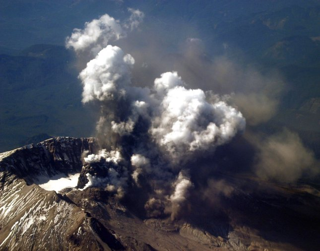 Washington state's Mount St. Helens, which erupted May 18, 1980, killing 57 people and destroying more than 200 homes, is shown on Oct. 1, 2004, emitting a plume of steam and ash. The picture was taken at an altitude of 27,000 feet from a U.S. Navy P-3C Orion aircraft. Scott Taylor/U.S. Navy/UPI File