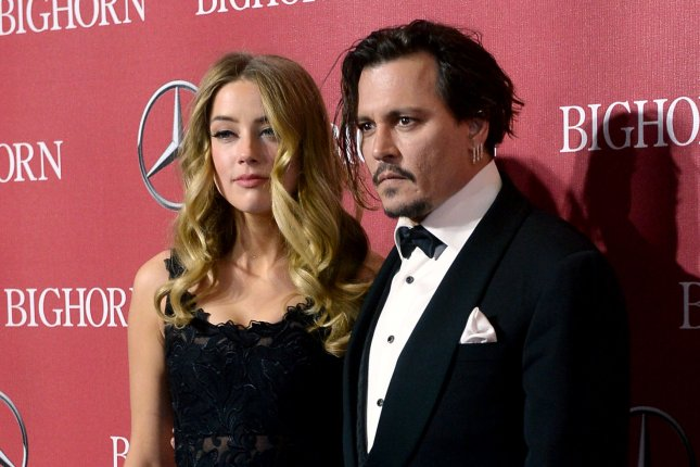 Amber Heard and Johnny Depp attend the 27th annual Palm Springs International Film Festival awards gala on January 2, 2016. Heard pleaded guilty for smuggling her pet dogs into Australia, leading to the charges being dropped. File Photo by Jim Ruymen/UPI