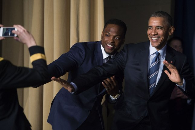U.S. President Barack Obama strikes the Heisman Trophy pose with Heisman Trophy winner Derrick Henry at the conclusion of the National Prayer Breakfast in Washington, DC, on February 4, 2016. For 63 years the National Prayer Breakfast has given presidents the opportunity to gather with members of congress and Christians to pray and talk about the role of prayer in their own lives. Pool Photo by Shawn Thew/UPI