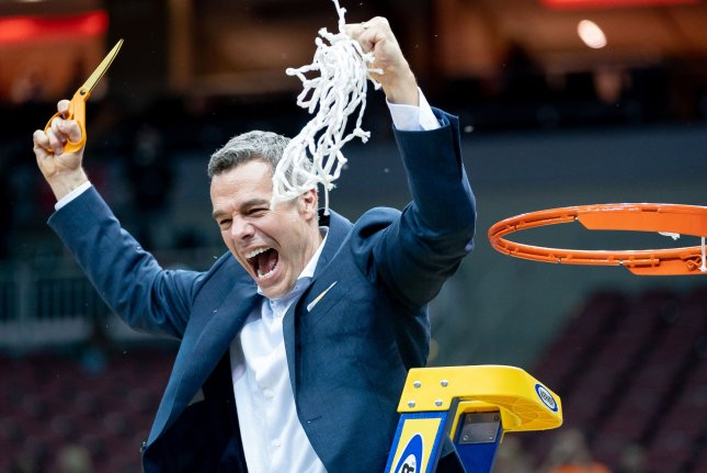 Virginia Cavaliers head coach Tony Bennett celebrates after cutting down the net after the regional final of 2019 NCAA Division I men's basketball tournament against the Purdue Boilermakers at the KFC Yum Center in Louisville, Ky., on Saturday. Photo by Bryan Woolston/UPI