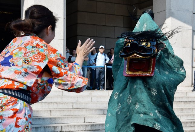 Lion dancers of Onagawa, Miyagi-Prefecture perform Shishikofuri style during an event for Tokyo Shishimai collection 2020 at the Tokyo National Museum. Photo by Keizo Mori/UPI