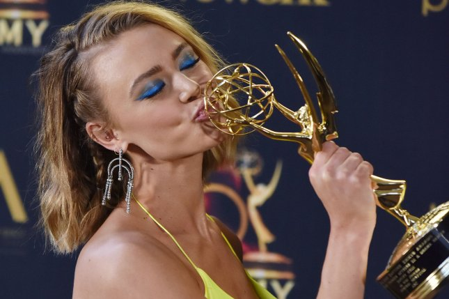 Hayley Erin kisses her Daytime Emmy for Outstanding Younger Actress in a Drama Series at the 46th Annual Daytime Emmy Awards on May 5. This year's event has been canceled over concerns about the COVID-19 virus. File Photo by Chris Chew/UPI