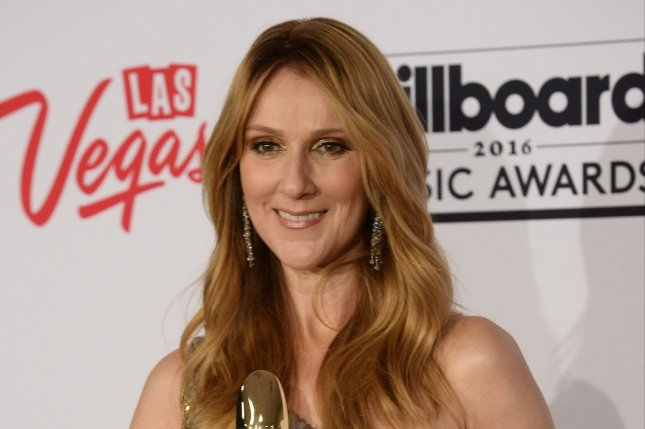 Celine Dion appears backstage with the Icon Award during the annual Billboard Music Awards on May 22. Dion will be joining Season 12 of The Voice as an advisor to Gwen Stefani. File Photo by Jim Ruymen/UPI