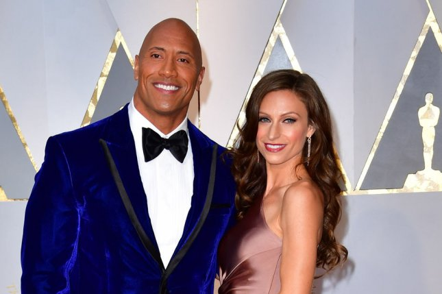 Ballers star Dwayne Johnson (L) and Lauren Hashian arrive on the red carpet for the 89th annual Academy Awards on February 26. HBO has renewed Ballers along with Insecure starring Issa Rae. File Photo by Kevin Dietsch/UPI