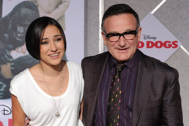 Zelda Williams (L), pictured with Robin Williams, explained her plan to celebrate the late actor's birthday in peace. File Photo by Jim Ruymen/UPI
