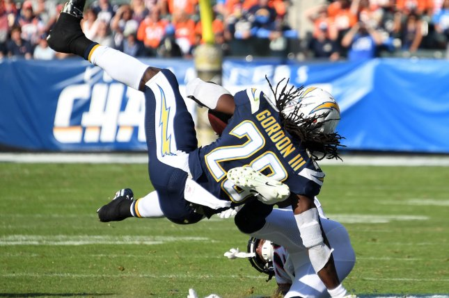 Los Angeles Chargers running back Melvin Gordon III (28) is tackled by Denver Broncos cornerback Bradley Roby (29) on November 18 at StubHub Center in Carson, Calif. Photo by Jon SooHoo/UPI