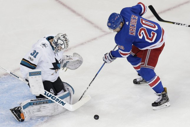 New York Rangers forward Chris Kreider (R) suffered the foot injury while blocking a shot in the first period against the Philadelphia Flyers on Friday. File Photo by John Angelillo/UPI