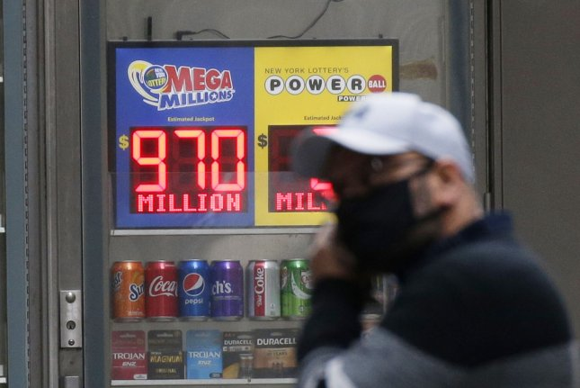 A sign showing Friday's Mega Millions drawing top prize of $970 million hangs in a store window in New York City. The jackpot later inched up to $1 billion, which was won by a ticket sold in Michigan. File Photo by John Angelillo/UPI
