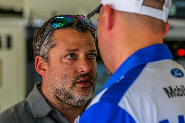 Stewart-Hass Racing Co-Owner Tony Stewart talks with Crew Chief Mike Bugarewicz of Clint Boyer's team before practice on February 24, 2017 in Daytona, Florida. Photo by Mike Gentry/UPI