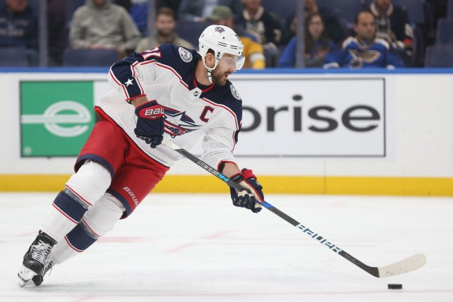 Columbus Blue Jackets' Nick Foligno brings the puck up ice against the St. Louis Blues in the first period on October 25 at the Enterprise Center in St. Louis. Photo by Bill Greenblatt/UPI