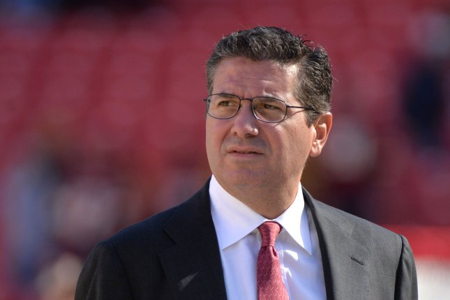 Washington Redskins owner Dan Snyder, shown on the field prior to a November 2013 game, on Friday announced the team will be conducting a thorough review of the team's name. UPI/Kevin Dietsch