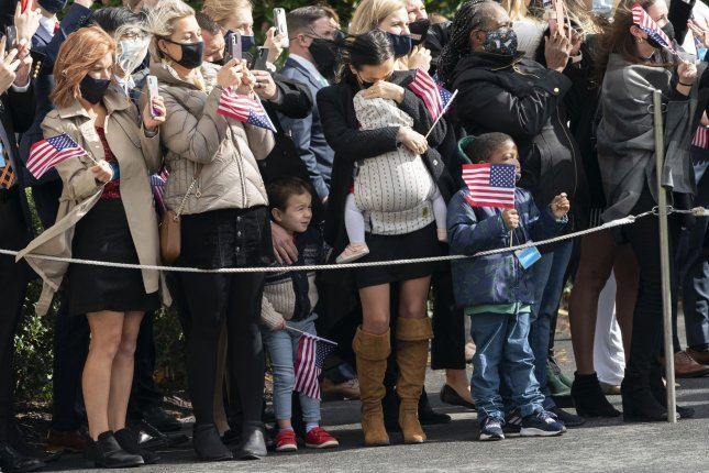 Guests watch as Marine One lands at the White House before President Donald Trump departs Friday for political rallies in Michigan, Wisconsin and Minnesota. Photo by Chris Kleponis/UPI