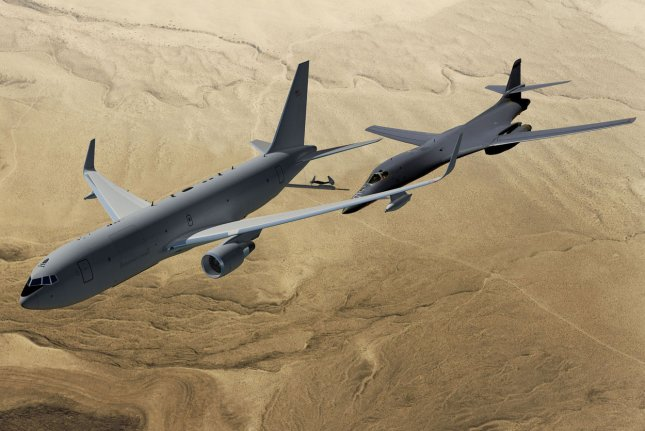 Boeing has won the $35 billion contract to build the next air-refueling planes it was announced by the Air Force in Washington on February 24, 2011. In this artist's conception, a Boeing KC-46A prepares to refuel a B-1 bomber in flight. UPI/Boeing HO