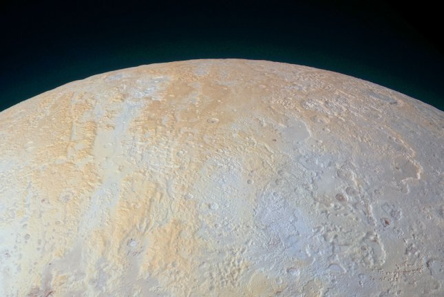 This ethereal scene captured by NASA's New Horizon spacecraft on July 14, 2015, tells yet another story of Pluto's diversity of geological and compositional features -- this time in an enhanced color image of the north pole area. Long canyons run vertically across the polar area -- part of the informally named Lowell Region, named for Percival Lowell, who founded Lowell Observatory and initiated the search that led to Pluto's discovery. File photo by UPI/NASA