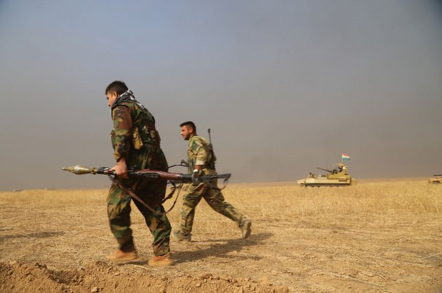 Kurdish Peshmerga soldiers take positions of attack against the Islamic State in the area of Dohuk, north of Mosul, on Thursday during a ground offensive to seize Mosul, Iraq. The Peshmerga on Sunday said the town of Bashiqa near Mosul is under its full control. Photo by Shvan Harki/UPI