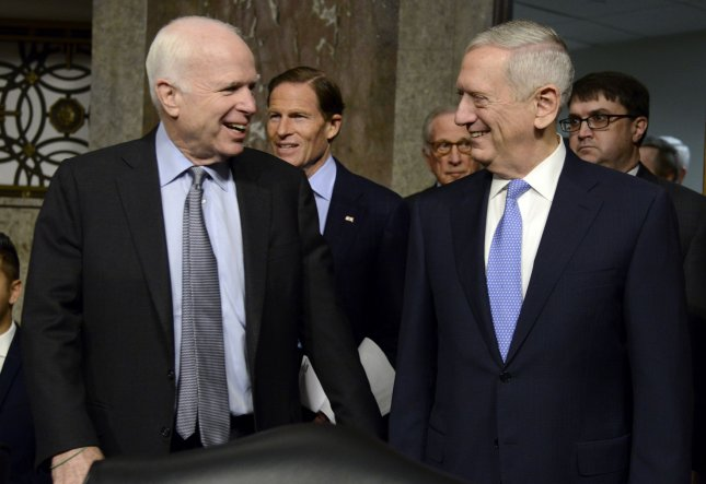 Retired Gen. James Mattis, (R), nominated to be secretary of defense, arrives with Sen. John McCain for his confirmation hearings before the Senate Armed Services Committee on Capitol Hill on January 12, 2017, in Washington, D.C. Mattis, a lifelong U.S. Marine, will need a Congressional waiver to serve, having been retired for less than seven years. Photo by Mike Theiler/UPI