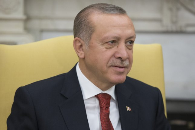 Turkish President Recep Tayyip Erdogan listens during a White House visit in May. Erdogan's government continued its crackdown on the human rights group Amnesty International, arresting nine members, including its Turkey director. File Photo by Michael Reynolds/UPI