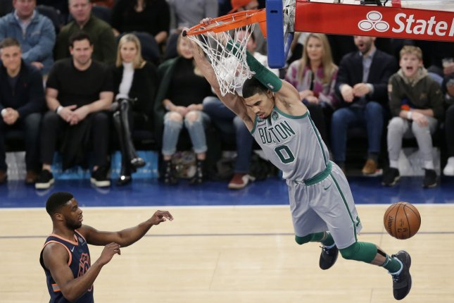 474eb7ce0 Boston Celtics rookie Jayson Tatum dunks the basketball in the first half  against the New York Knicks on February 24 at Madison Square Garden in New  York ...