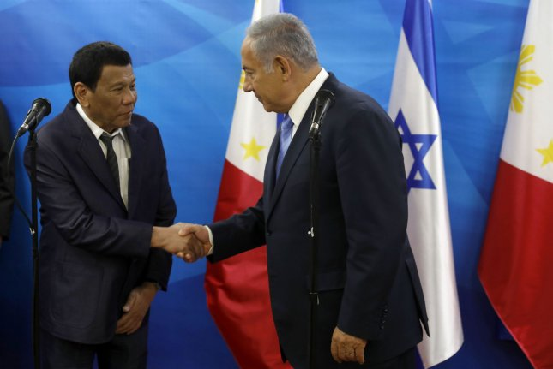 Israeli Prime Minister Benjamin Netanyahu (R) shakes hands with Philippine President Rodrigo Duterte during their meeting in Jerusalem on Monday. Pool photo by Ronen Zvulun/UPI