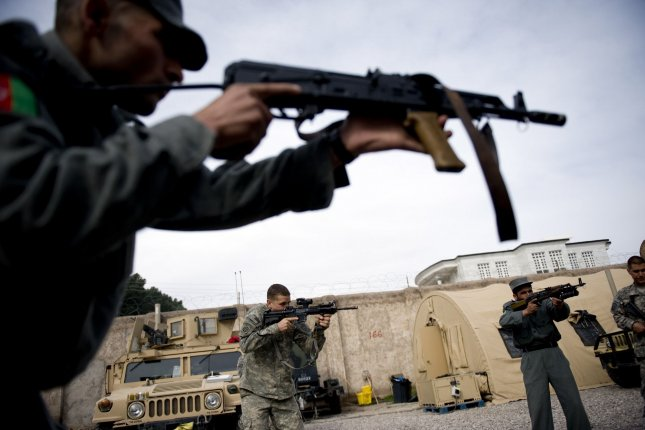 U.S. Army soldiers lead a military training exercise for Afghan National Police officers in Herat, Afghanistan. The ICC ruling Thursday authorizes investigations into potential war crimes committed by U.S. personnel. File Photo by Hossein Fatemi/UPI