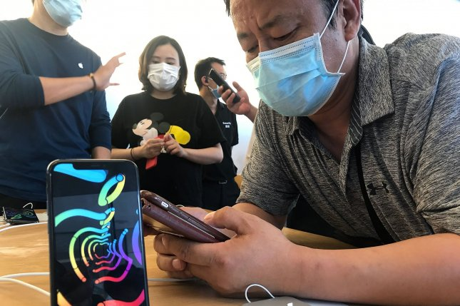 Customers visit an Apple store in Beijing on Sunday. The tech giants kicked off its WWDC 2020 developers conference Monday. Photo by Stephen Shaver/UPI