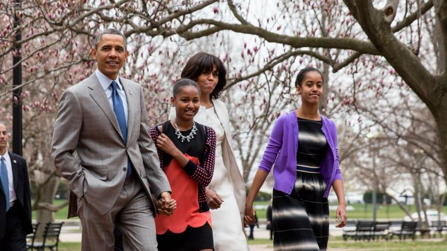 US President Barack Obama, daughter Sasha, First Lady Michelle Obama and daughter Malia walk from the White House across Lafayette Park on their way to church at St John's Episcopal Church in Washington, DC on March 31, 2013. UPI/Drew Angerer/Pool