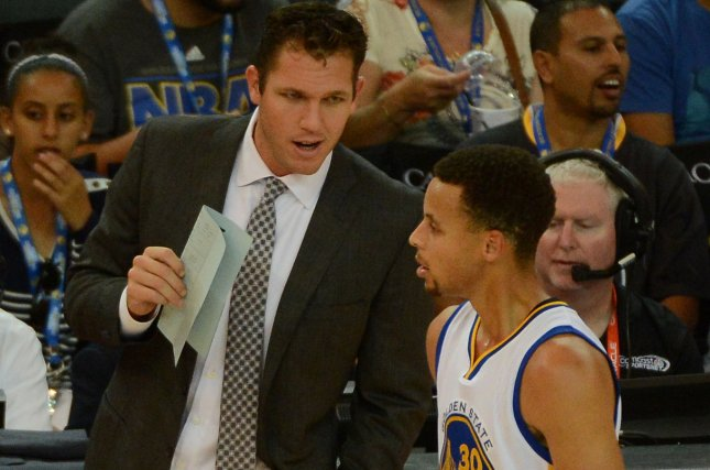 Golden State Warriors' Stephen Curry (30) talks with interim coach Luke Walton in the first quarter of a preseason game against the Denver Nuggets at Oracle Arena in Oakland, California on October 13, 2015. Photo by Terry Schmitt/UPI