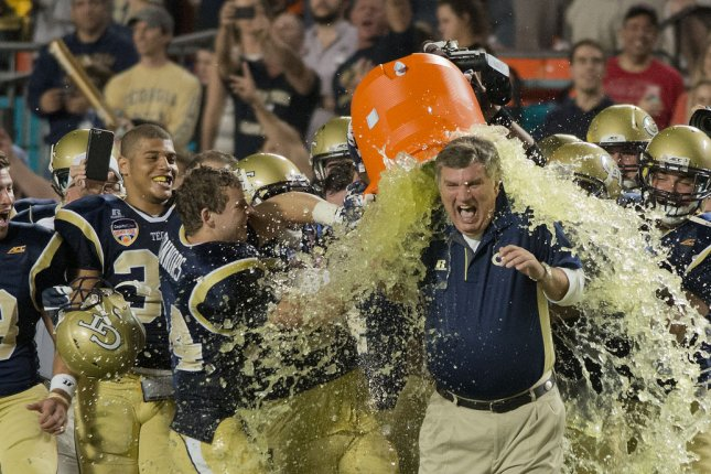 Georgia Tech head coach Paul Johnson gets dunked with Gatorade after beating Mississippi State in the 2014 Orange Bowl. Photo by Gary I Rothstein/UPI