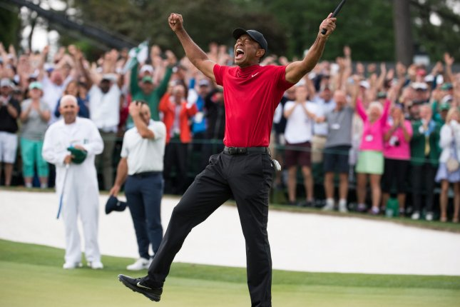 Tiger Woods celebrates Sunday after winning the Masters in Augusta, Ga. Photo by Kevin Dietsch/UPI