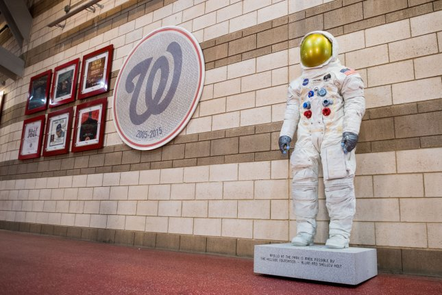 An exact replica of Neil Armstrong's spacesuit that he wore on the moon is unveiled at Nationals Park in Washington, D.C., on Tuesday. Photo by Kevin Dietsch/UPI