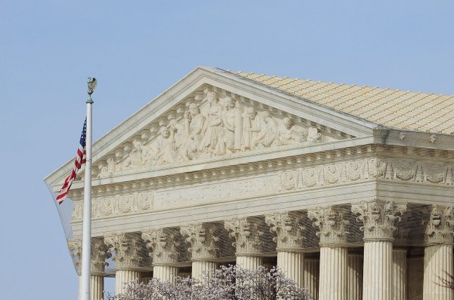 Six of the nine justices are 65 and older, which puts them at higher risk over the coronavirus disease.File Photo by Roger Wollenberg/UPI