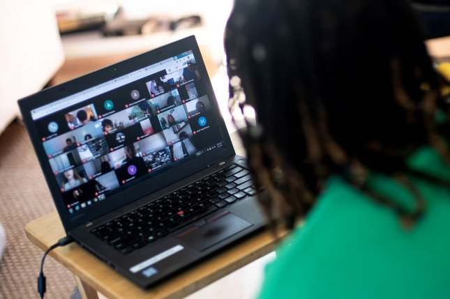 Imani Baucom, a second grade English teacher, communicates Monday with students remotely from her home in Bowie, Md. The coronavirus pandemic has made working remotely more commonplace and vital to enduring the health crisis. Photo by Kevin Dietsch/UPI